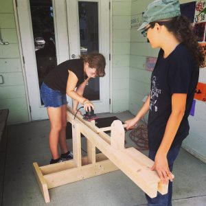 As a service project and part of their woodworking class, the Saltmeadow students built a seesaw for the early childhood students at the Mangrove School of Sarasota.